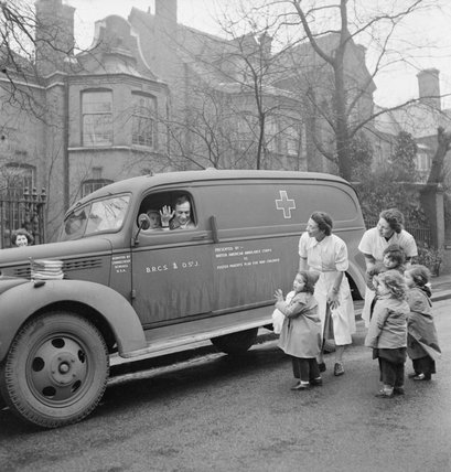 Eric Muggeridge, Director of the 'Foster Parents Plan for War Children' leaves a Nursery in Hampstead, London during 1941.