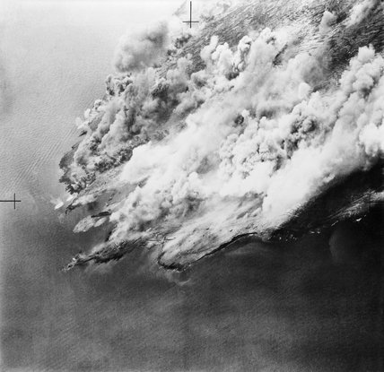 The island of Pantelleria in the Mediterranean, wreathed in smoke from bursting bombs during the Allied bombardment of June 1943. Capture of the island was a vital precursor to the invasion of Sicily in July.