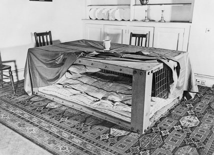 A Morrison shelter set up in a  diningroom, 1941.