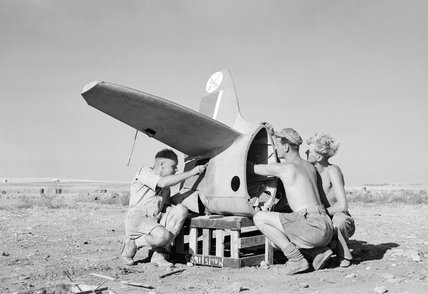 A party of riggers working on the tailplane of a Supermarine Spitfire of No. 601 Squadron at Lentini West, Sicily, 7 September 1943.
