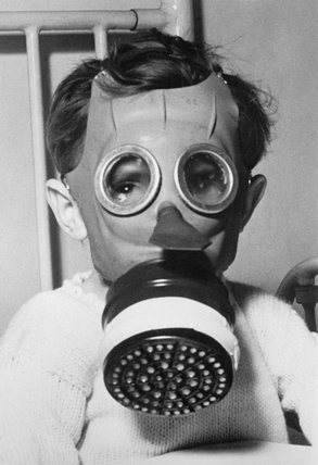 Child wearing a 'Mickey Mouse' gas-mask during the Second World War.