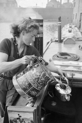 Miss March makes a cup of tea on board her narrowboat the 'HEATHER BELL' in 1942.