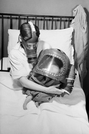 A mother and baby both in gas-masks during 1941.