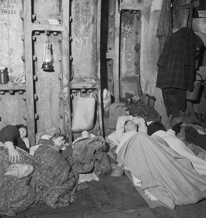 A family sleeping in Liverpool Street Underground Station during an air raid in November 1940.