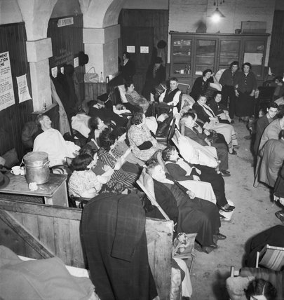 Londoners using the crypt of Christ Church, Spitalfields, as an air raid shelter during 1940.