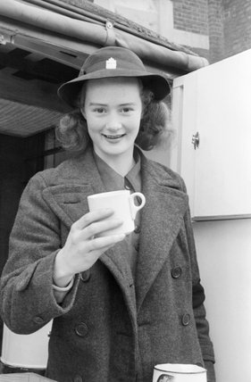 Miss Patience Brand working for the Women's Voluntary Service running a mobile canteen in London during 1941.