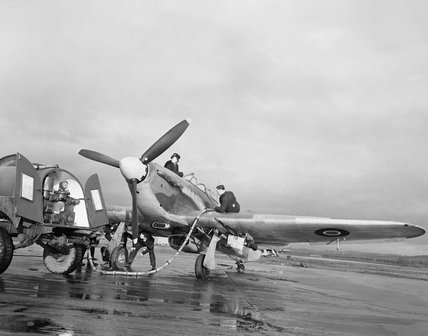 Ground crew refuel a Hawker Hurricane Mk IID of No. 1 Specialised Low Attack Instructors School at Milfield, Northumberland, prior to a training sortie, 21 January 1943.
