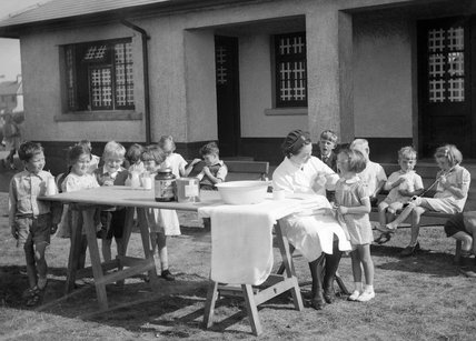 Evacuees from All Saints and Blackheath and Kidbrooke Schools, Greenwich, London attend a visit by a nurse at their new school at Penygroes, Carmarthenshire, Wales in 1940.