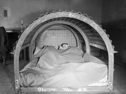 Demonstration of a prototype indoor air raid shelter in 1941.