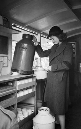 A member of the Women's Voluntary Service (WVS) in her mobile canteen during 1941.