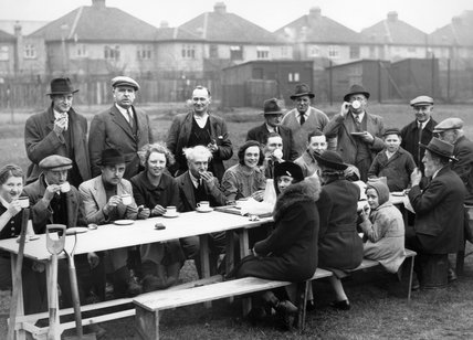 Amateur gardeners down tools for tea and sandwiches on an alloment in Acton during the 'Dig For Victory' campaign in 1940.