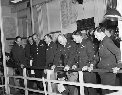The Supreme Commander of the Allied Expeditionary Force, General Dwight D Eisenhower, accompanied by his senior air commanders, watching activities in the Operations Room at HQ Air Defence of Great Britain (formerly RAF Fighter Command) at Bentley Priory,