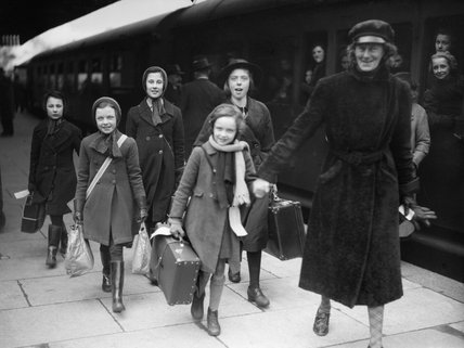 A group of evacuees from Bristol are led along the platform on arrival at Brent Station near Kingsbridge in Devon during 1940.