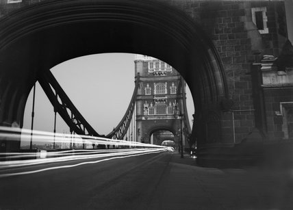 Looking across Tower Bridge through the traces of car headlights, 1940.