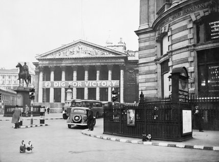 The Royal Exchange in London in use as a Ministry of Information 'special poster site' with a 'Dig for Victory banner' across the entrance in 1940.