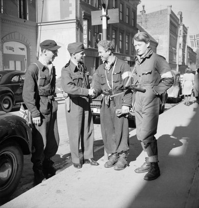 Squadron Leader J Macadam meets three Norwegian resistance fighters in Oslo following the arrival of British forces in Norway, 11 May 1945.