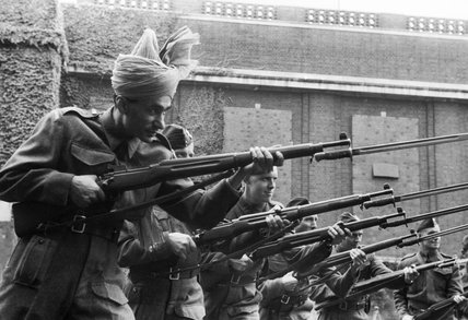 Poet and radio broadcaster Z A Bokhari attending bayonet drill with the rest of his colleagues in the BBC Home Guard at Bedford College in 1941.