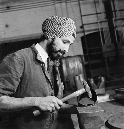 A Sikh technician working with metal tubing at the Government Training Centre, Letchworth in 1941.