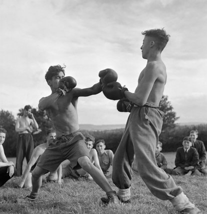 Two Youth Service Volunteers having a boxing match at an agricultural camp at Nunney Catch in Somerset during 1943.