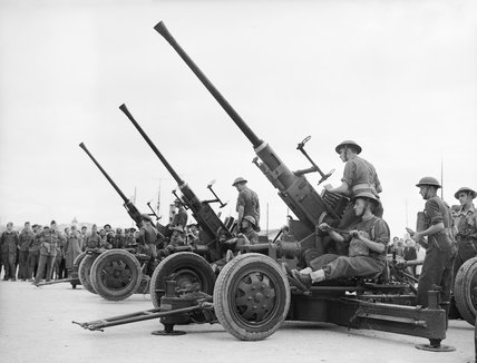 Royal Artillery 40mm Bofors guns being assembled on their arrival in Greece, 25 November 1940.
