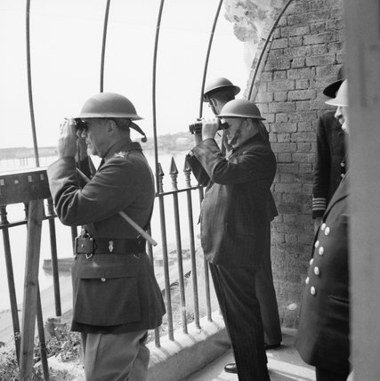 Winston Churchill viewing activity in the Channel from an observation post at Dover Castle during his tour of defences, 28 August 1940.