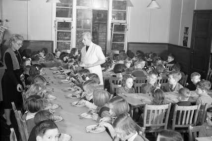 Lunchtime in the canteen at Chipstead Council School in Surrey during 1942.