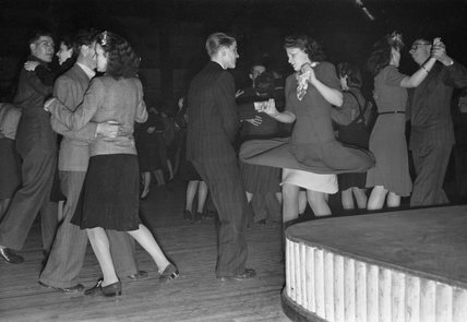 A couple at a British dance hall try out 'jive' steps in 1945.