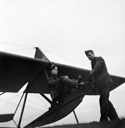 Corporal George Metcalfe of the Air Training Corps receives instruction in gliding from Flight Lieutenant Whelton during 1944.