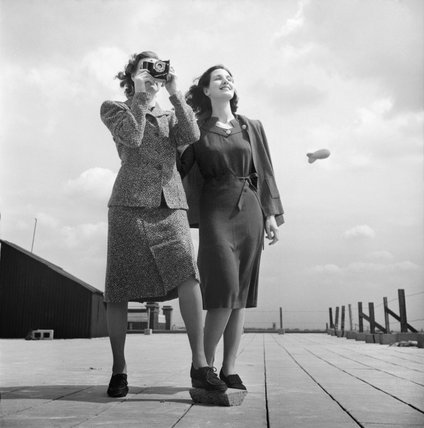 Two models on a rooftop in Bloomsbury, London, wearing wartime fashions in 1943.