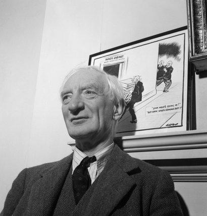 Sir William Beveridge in his study at University College Oxford, 1943.