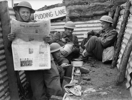 Men of the 1st Queen's Own Royal West Kent Regiment enjoy a tot of rum in a section of trench named 'Pudding Lane', near Roubaix in France, 3 April 1940.