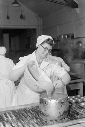 A pupil at the National Training College of Domestic Science in Westminster, London, in a cookery class, 1944.