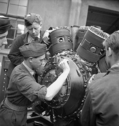 Belgian trainees at work on a Hercules aero-engine at the Belgian Air Training School at Snailwell in Cambridgeshire, 1945.