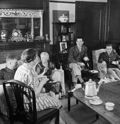 American officers take tea in a house in Winchester, Hampshire during 1944.