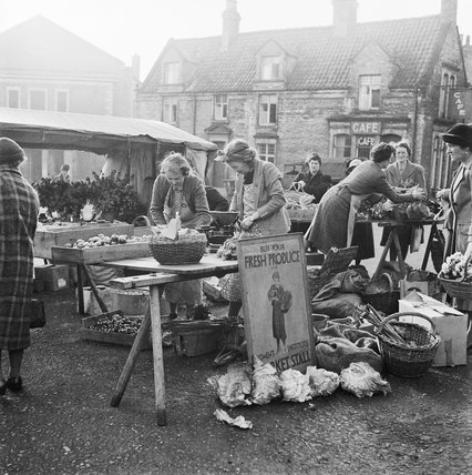 Members of the Women's Institute (WI) selling home produce on stalls at Malton, Yorkshire, during the Second World War.