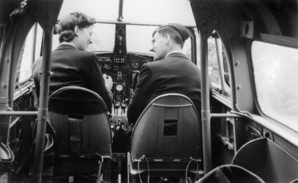 An Air Transport Auxiliary (ATA) flying instructor, Miss J Broad, with a male pupil in an Airspeed Oxford training aircraft.