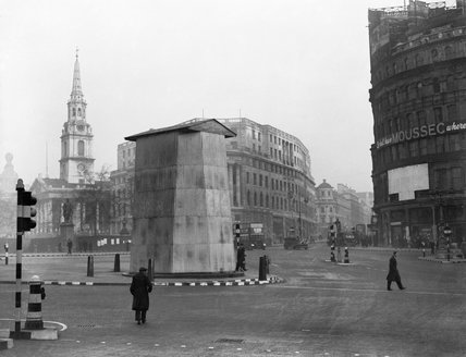 The corrugated metal structure erected to protect the statue of King Charles I in Trafalgar Square, London, 1939.