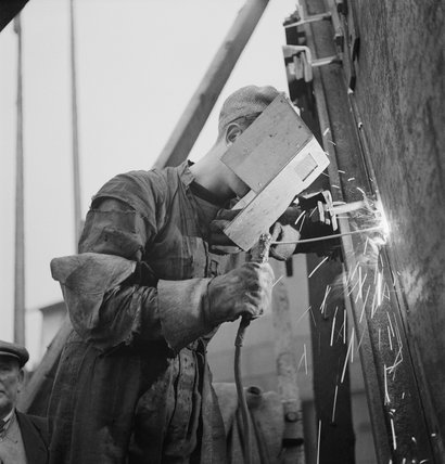 A welder at work in a Tyneside shipyard during 1943.