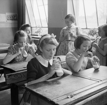 Girls at Baldock County Council School in Hertfordshire enjoy a drink of milk during a break in the school day in 1944.