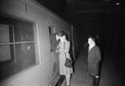 At London's King's Cross station in London a serviceman kisses his wife goodbye as he heads for his unit in Scotland in 1944.