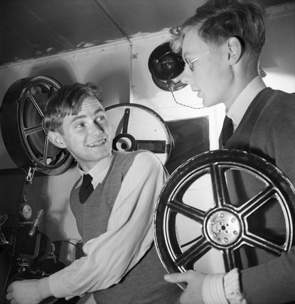 Two puplis at Ampleforth College in Yorkshire preparing to show a film in the school cinema during 1943.