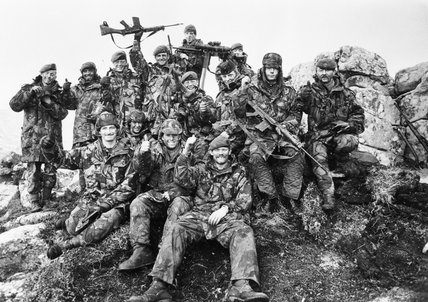 7 Platoon, 'G' Company, 2nd Battalion Scots Guards on Mount Tumbledown, celebrate the news of the Argentine surrender at dawn on 14 June 1982.