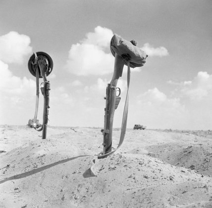 The graves of two Scottish soldiers are marked by upturned rifles in the sand, North Africa, 5 November 1942.