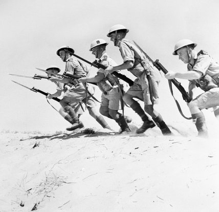 Men of the 51st Highland Division charging with fixed bayonets during a training exercise in the desert, North Africa, 23 September 1942.