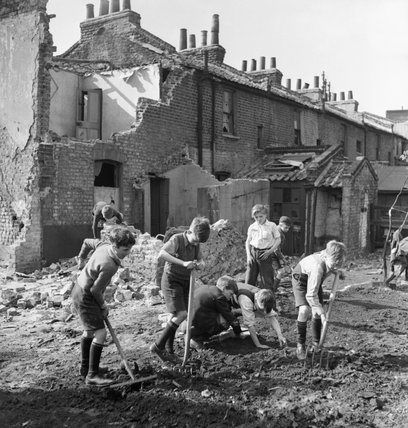 Boys creating an allotment on a bomb site in London during 1942.