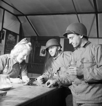 US soldiers purchasing bottles of mineral water at a NAAFI canteen in England during 1943.