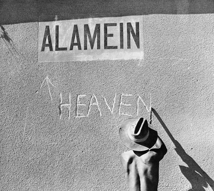 An Australian soldier re-names the railway station at El Alamein, 14 August 1942.