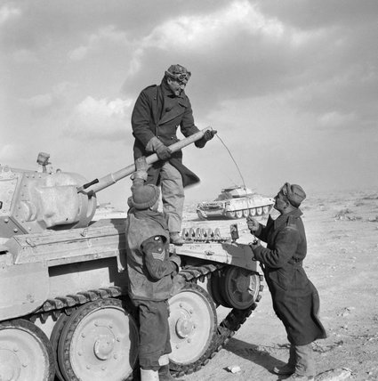 The crew of a Crusader tank cleaning the barrel of its 2-pdr gun, North Africa, 6 February 1942.