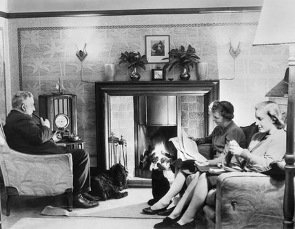 A family relaxes at home in Taunton, Somerset, on a Sunday afternoon during 1942.