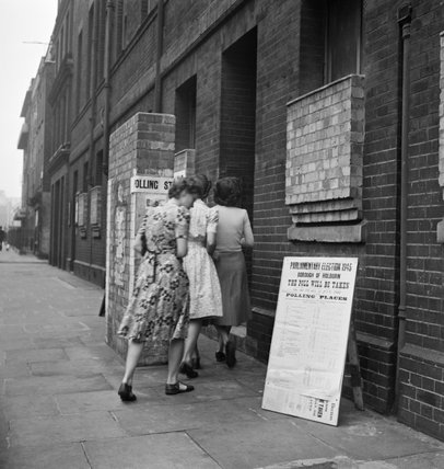 Voters arriving at a polling station in the Italian Hospital, Queen Square, Holborn, London to cast their vote in the General Election of 1945.